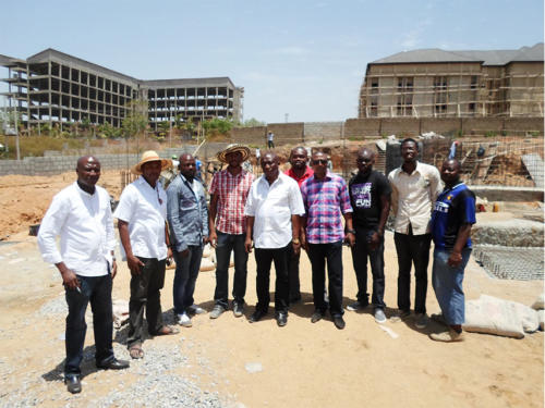 A Group Photo of the Project Monitoring Team and the Construction Staff on Site
