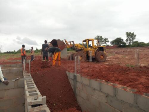 The Filling of the Foundation with Laterite